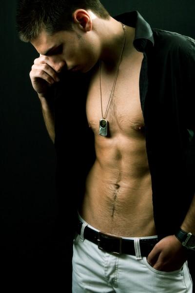 Sexy handsome man with muscular abdomen
