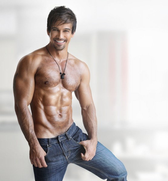 Sexy smiling shirtless male model with muscular body and abs aga
