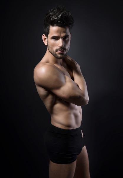 handsome young muscular man posing shirtless