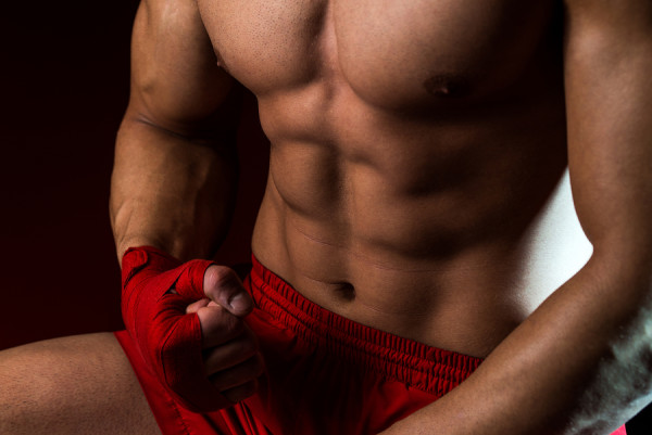 Muscled Boxer Wearing Red Strap On Wrist