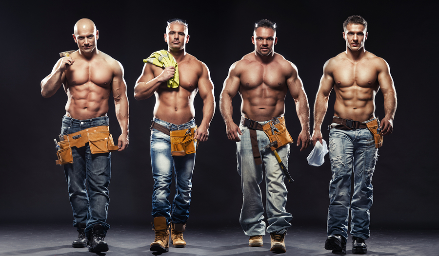 Group of young handsome builder posing on dark background