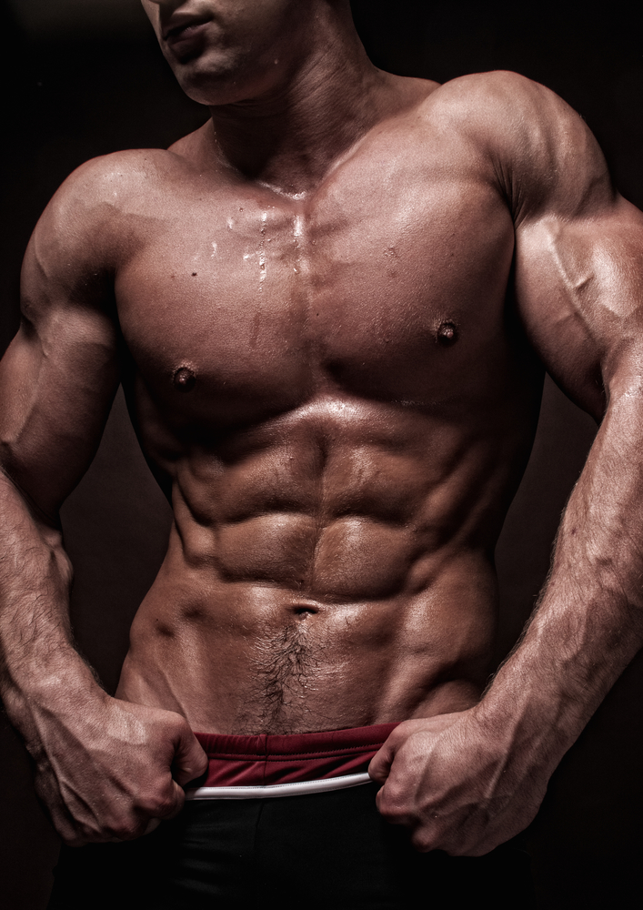 Muscled male torso with strong abs