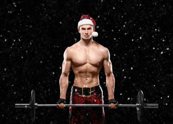 Holidays and celebrations New year Christmas sports bodybuilding healthy lifestyle - Muscular handsome sexy Santa Claus Ded Moroz